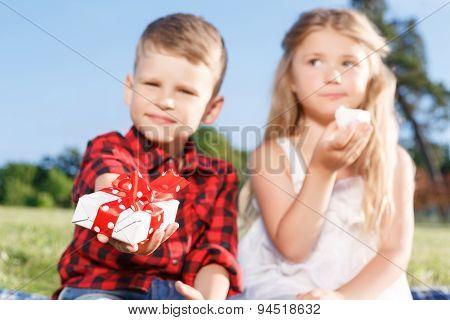 Vivacious little boy and girl eating marshmallow