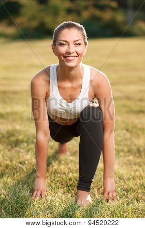 Attractive young lady doing exercises