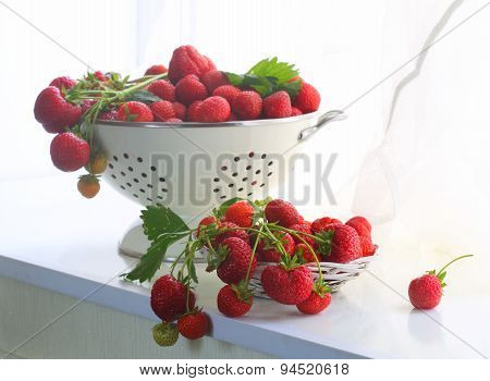 Strawberry In A Wattled Cup On A White Window Sill