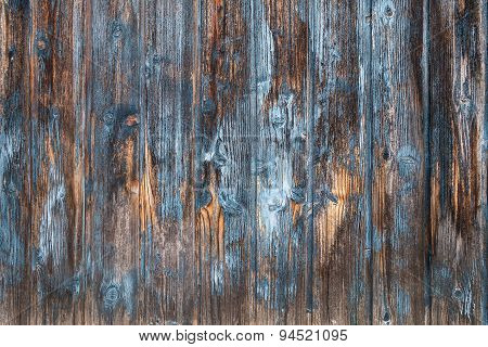 Weathered brown and blue wooden facade