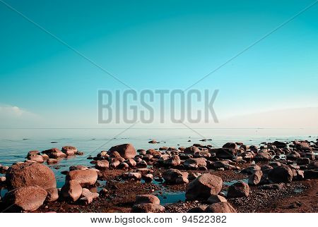The rocky coast and calm water
