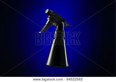 Black Mini Spray Bottle Over Blue Background