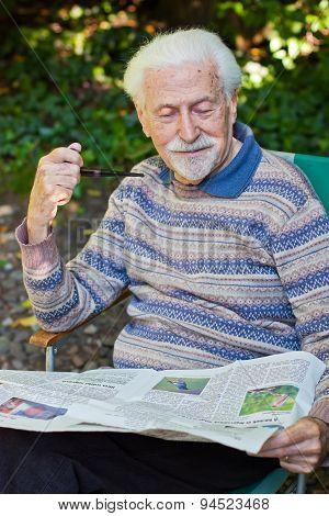 Elderly Gentleman Reading The Paper