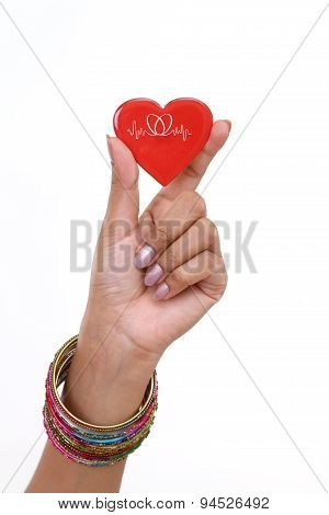 Red Heart Shape In Woman's Hand Isolated On White Background
