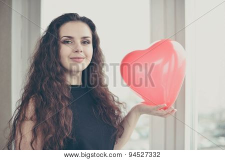 Attractive Caucasian Woman Holding A Baloon Heart