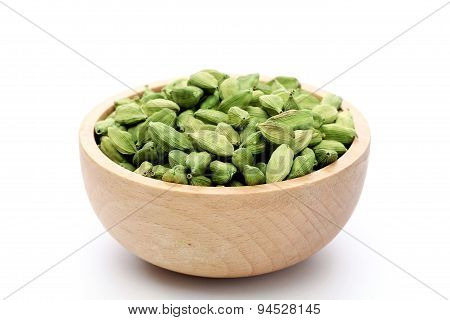 Cardamom Pods In A Wooden Bowl
