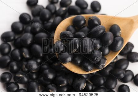 A Lot Of Black Soybeans On Wooden Background