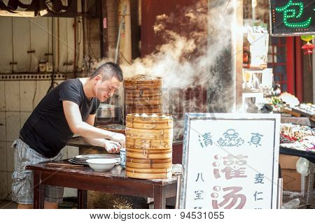 Steaming dumplings at Muslim Street