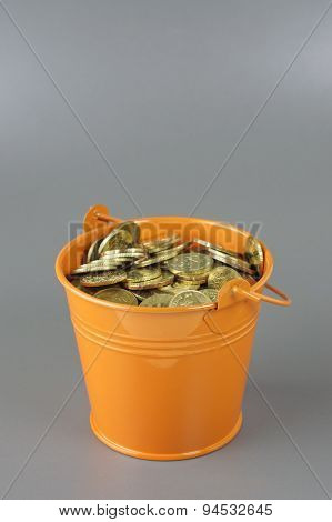 Gold Coins In The Bucket - Financial Concept
