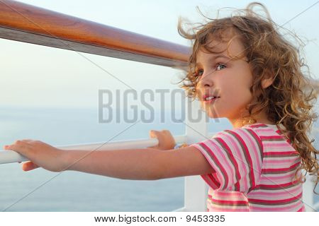 Little Curl Girl Standing On Cruise Liner Deck, Hands On Rail, Half Body, Looking Left