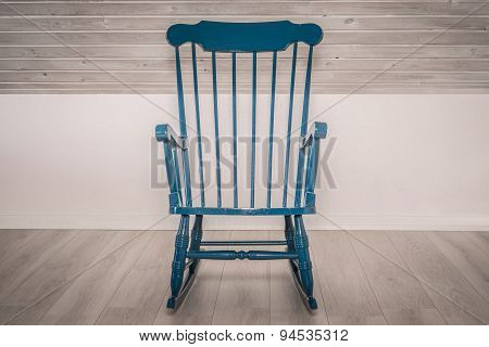 Rocking Chair On Wooden Floor
