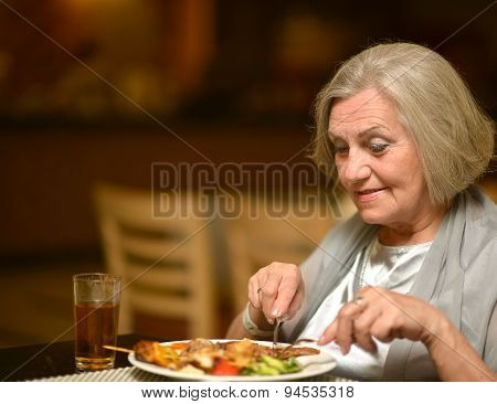 Senior woman having dinne