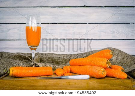 Carrot Juice On A Wooden Board