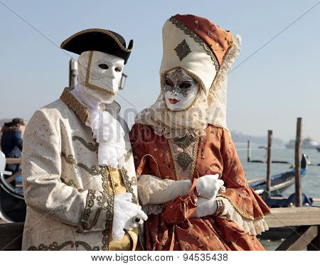 Persons In Venetian Mask And Romantic Costumes, Carnival Of Venice.