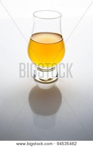 Apple vinegar in a glass on white