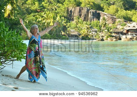 Elderly woman  on beach