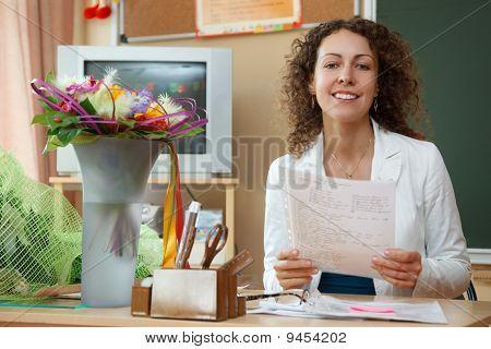 Portrait of schoolteacher in a white blouse in school.