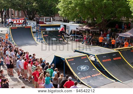 Crowd Watches BMX Pro Perform Ramp Tricks In Athens Competition