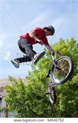 Teenager Performs Midair Stunt In Pro BMX Bike Competition