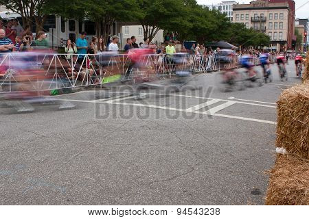 Motion Blur Of Cyclists Speeding Through Turn In Amateur Race