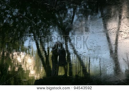 Abstract image of two lovers in the water.