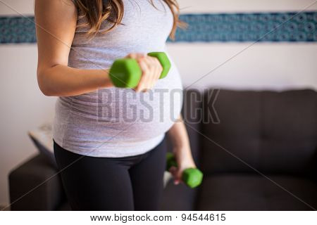 Pregnant Woman Lifting Weights