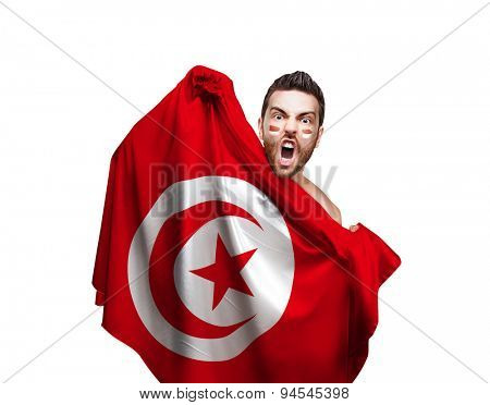 Fan holding the flag of Tunisia on white background