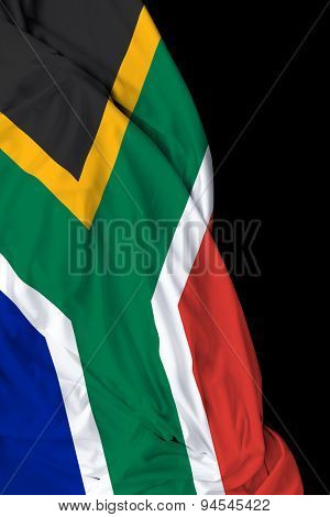 South African waving flag on black background