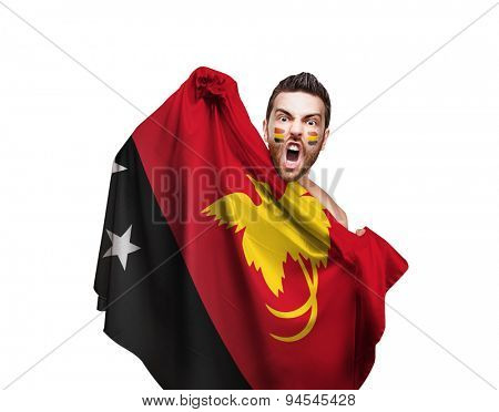 Fan holding the flag of Papua New Guinea on white background