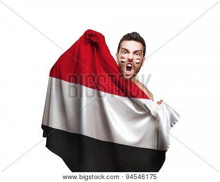 Fan holding the flag of Yemen on white background