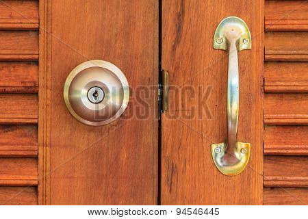 doorknob with wooden door