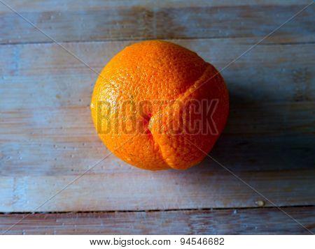 Orange fruit on a colored background.