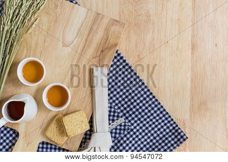 Wood Texture Background With Cups Of Tea And Biscuits