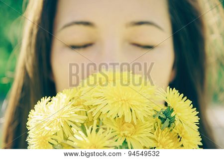 Beautiful Young Woman With Yellow Dandelions