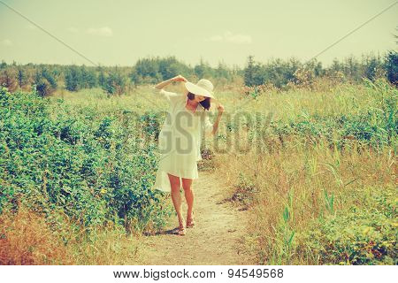 Smiling Woman Walking In Summer Park