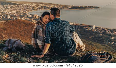 Loving Couple Resting Outdoor At Sunset