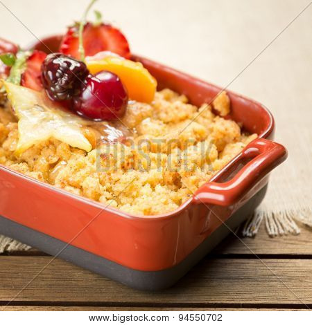 Apple Crumble On A Wooden Background