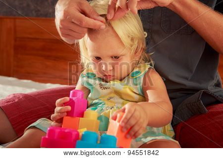 Girl Plays Toy Constructor Father Brushes Her Hair Closeup