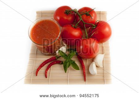 Tomatos With Glass Of Juice Isolated On White Background