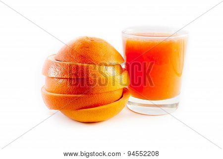 Grapefruit And Glass Of Juice Isolated On White Background