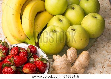 Still Life Of Bananas, Apples, Strawberries And Ginger.