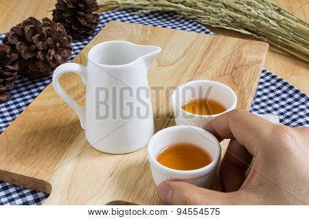 Taking Tea Cup On Wood Texture Background