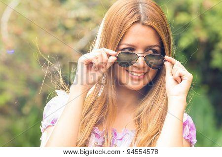 Woman model posing in green park