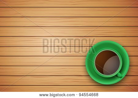 Green Cup of coffee or tea on the table dark wood