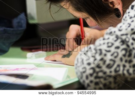 Tattoo artist working