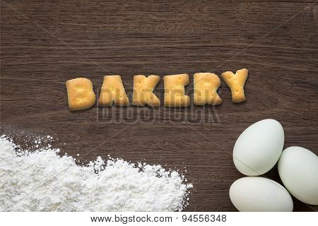 Letter Biscuits Word Bakery On Kitchen Table Background