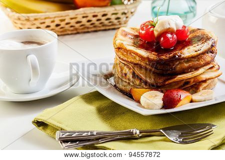 Pancakes With Chocolate Sauce Fruit And Coffee
