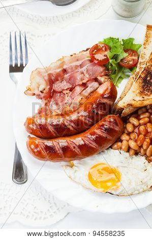Full English Breakfast With Bacon, Sausage, Fried Egg And Baked Beans