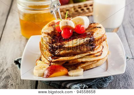 Pancakes With Chocolate Sauce Fruit And Glass Of Milk