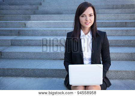 Beautiful Business Woman Sitting On Stairs With Laptop
